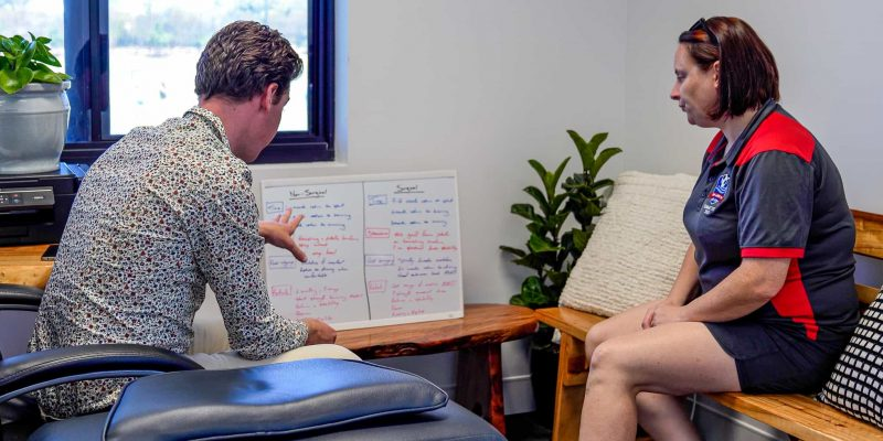 Discussing surgical and non-surgical care options with a client.