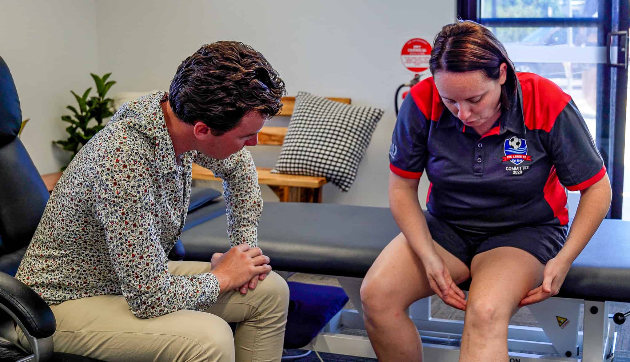 A client displaying the location of her knee pain symptoms following a soccer injury.